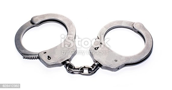 istock handcuffs isolated in white blackground 625412352