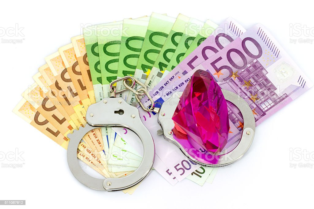 Handcuffs, money and diamond stock photo
