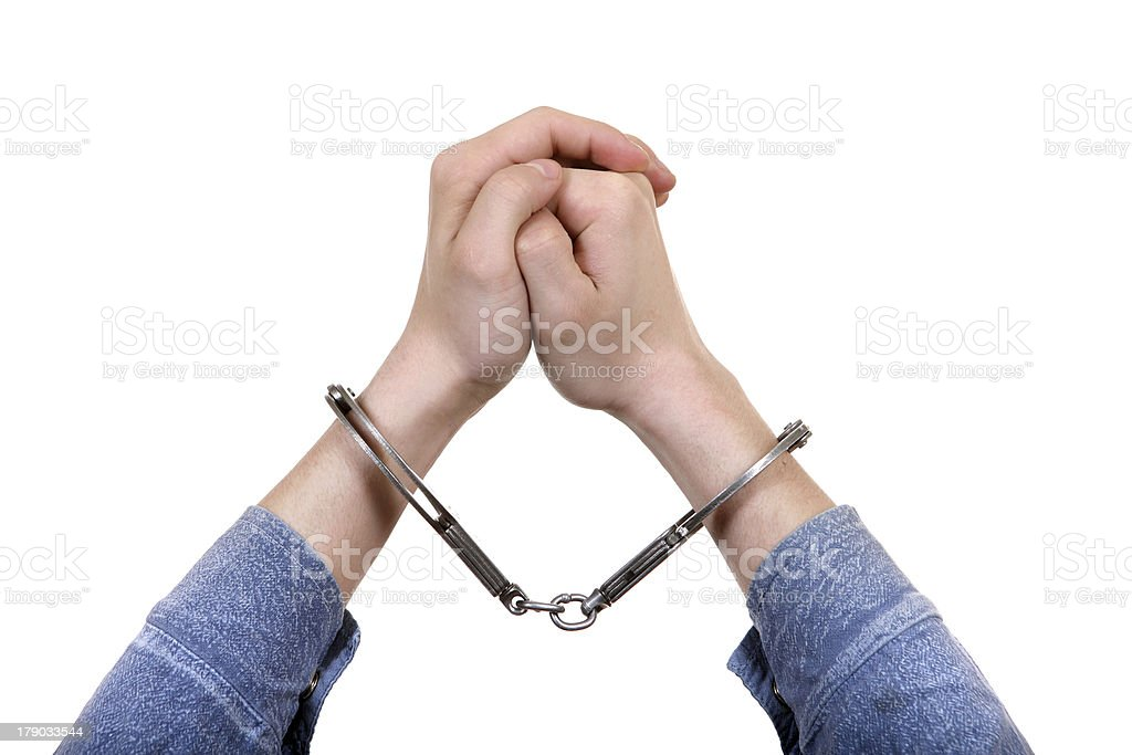 Handcuffs on Hands closeup royalty-free stock photo