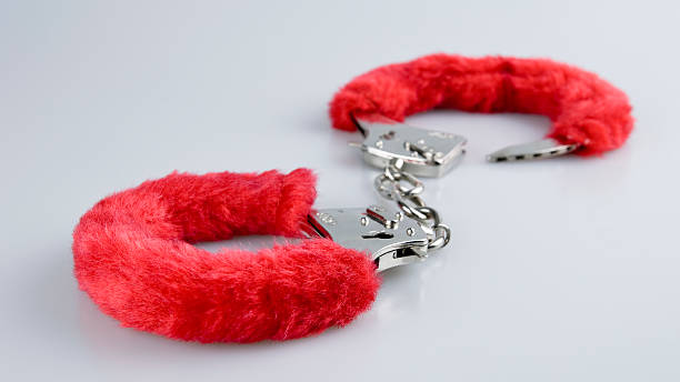 Handcuffs plushy handcuffs close up sex toy stock pictures, royalty-free photos & images