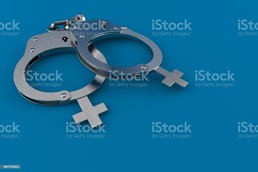 Handcuffs with female gender symbol royalty-free stock photo