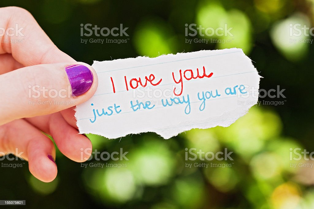 Hand-drawn message: loving just the way you are royalty-free stock photo