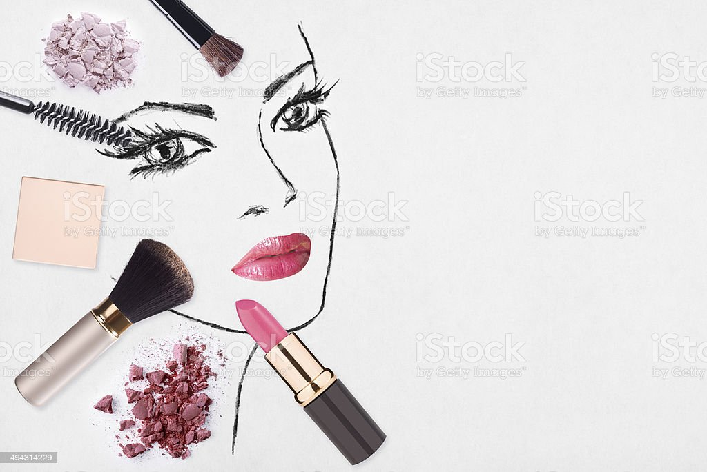Hand-drawn woman face and make up products stock photo