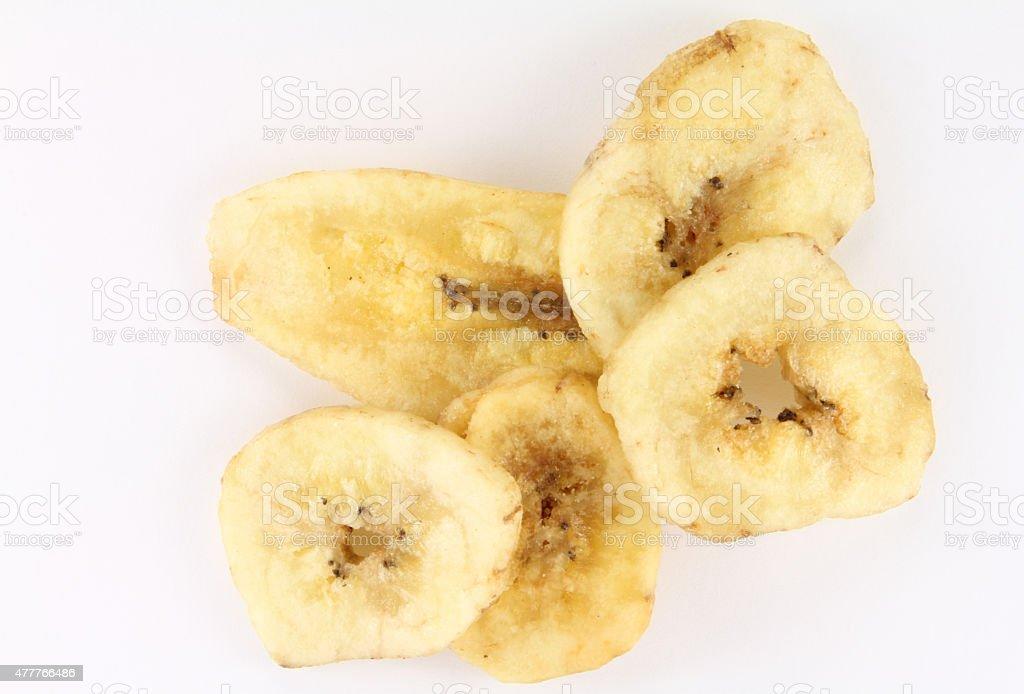 Handful of banana chips stock photo
