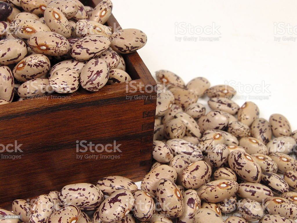Handful of beans in wooded pot royalty-free stock photo