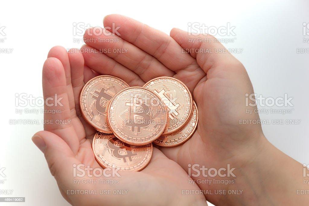 Handful of Bitcoin stock photo