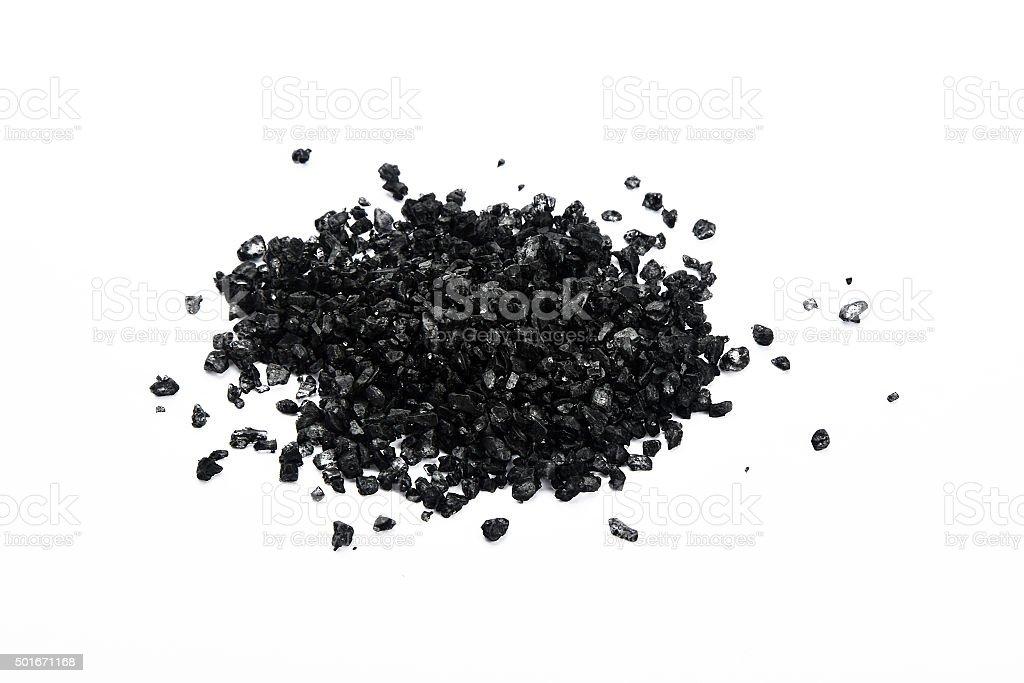 Handful of black Hawaiian sea salt isolated on white royalty free stockfoto