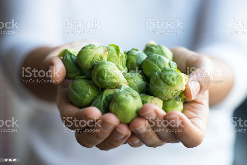 Handful of brussell sprouts stock photo
