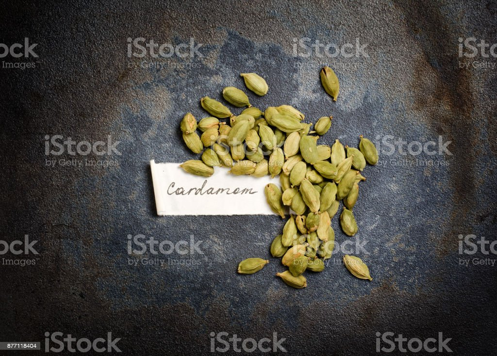 Handful of cardamom seeds with manually signed paper label stock photo