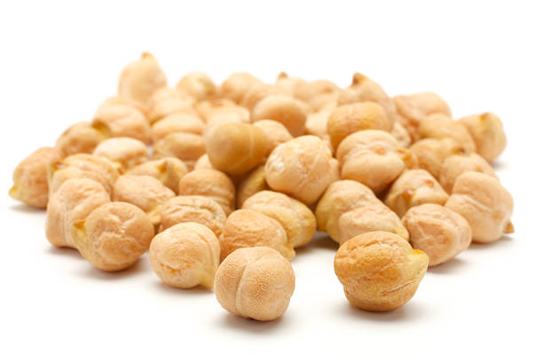 A handful of chick-pea A small handful of chick-pea. Beans isolated on a white background. Close-up. chick pea stock pictures, royalty-free photos & images