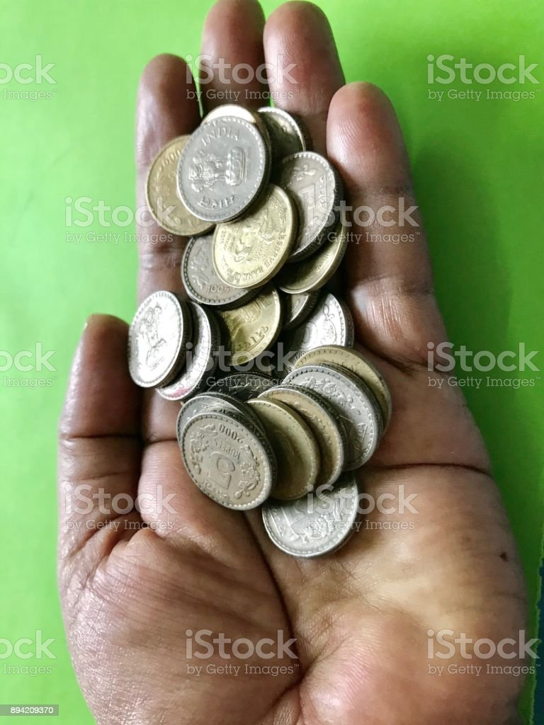 A handful of coins stock photo