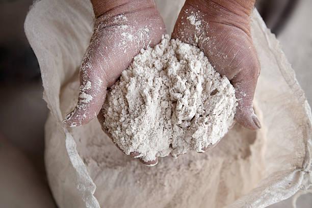 Handful of flour stock photo