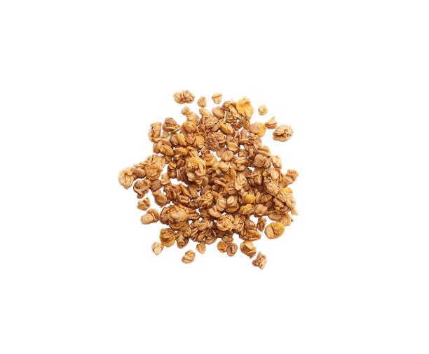 handful of granola oatmeal isolated on white background, top view. - granola imagens e fotografias de stock