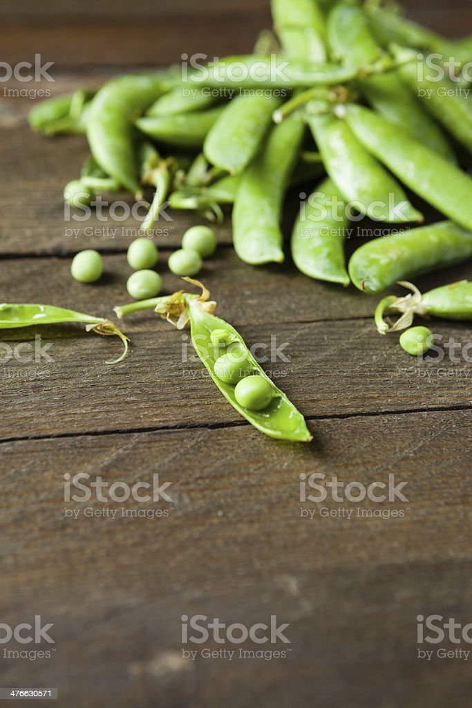 handful of green peas on wooden boards royalty-free stock photo