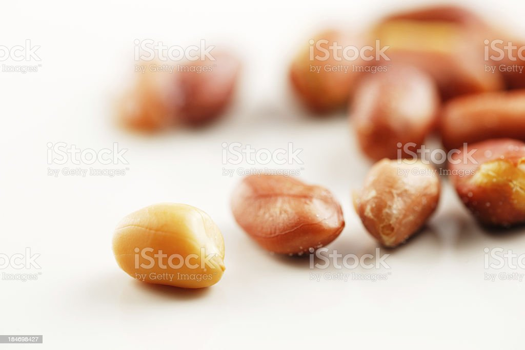 Handful of peanuts on a white background royalty-free stock photo
