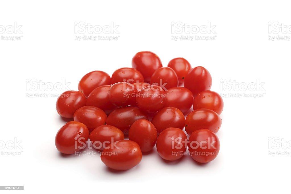handful of plum tomatoes stock photo