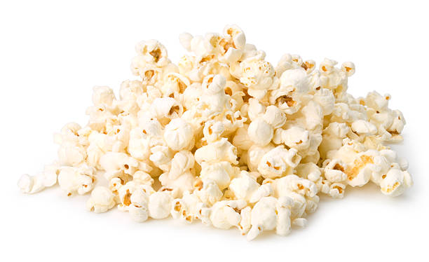 Handful of popcorn isolated on a white background stock photo