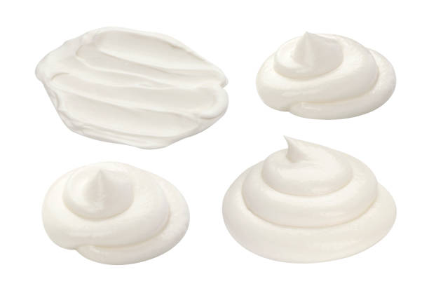 Handful of sour cream isolated on white background Handful of sour cream isolated on white background scooping stock pictures, royalty-free photos & images