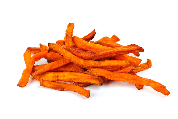 A handful of sweet potato fries on a white background stock photo