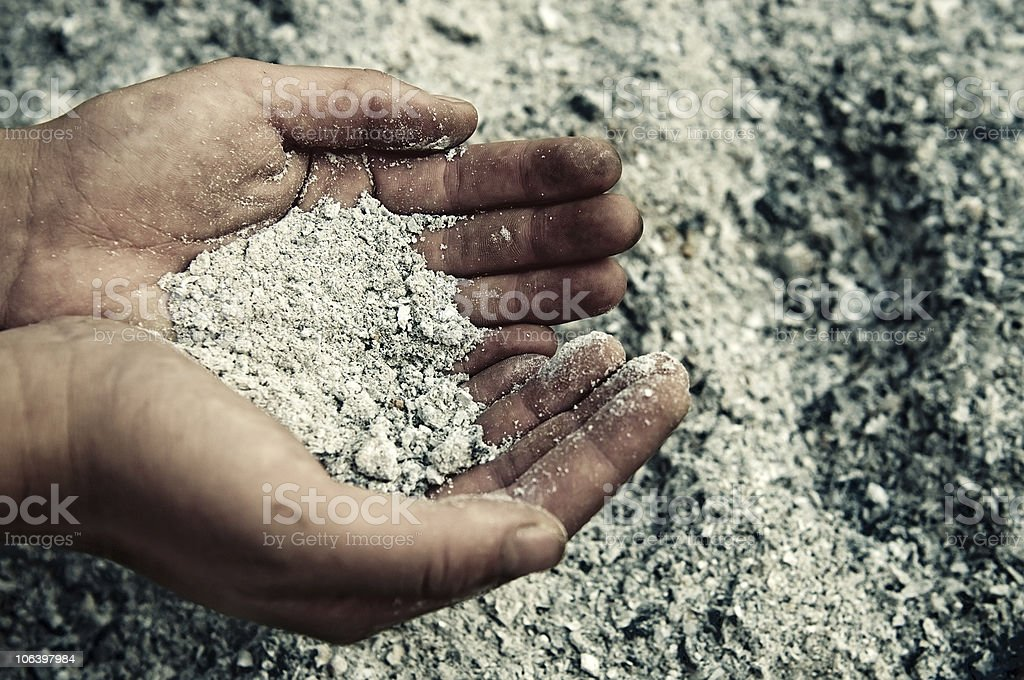 handfuls of ashes stock photo