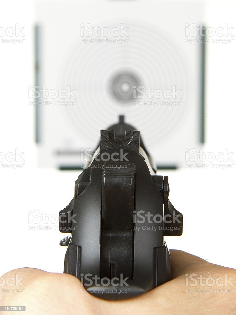 Handgun aimed on a shooting target stock photo