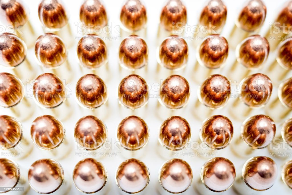 handgun ammo rounds close up bronze on white stock photo