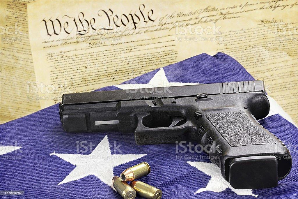 Handgun and Constitution stock photo