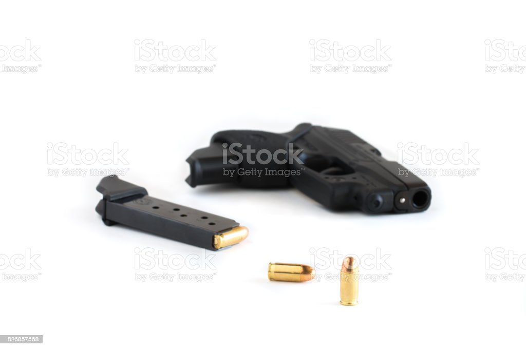 Handgun and magazine loaded with cartridges. stock photo