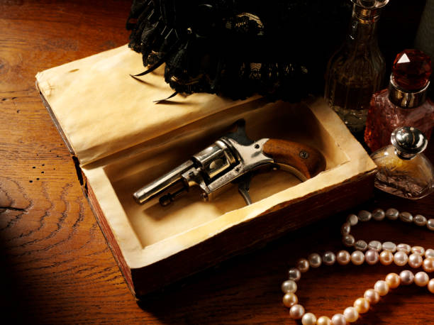 handgun and murder mystery - murder mystery stock photos and pictures