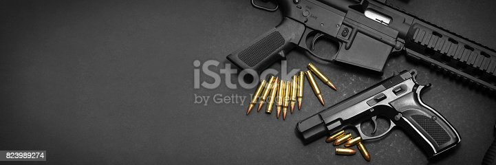 istock Handgun and rifle 823989274