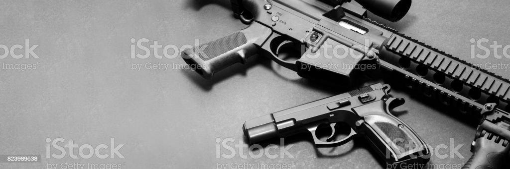 Handgun and rifle stock photo