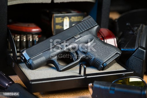 istock Handgun and Safe 168859454