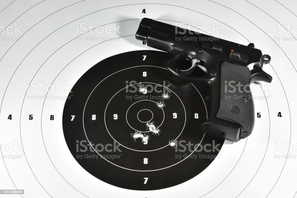handgun and target stock photo