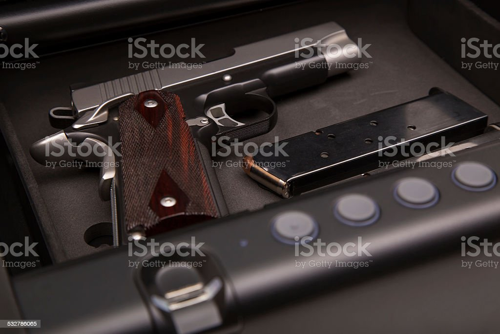 Handgun in Safe Box stock photo