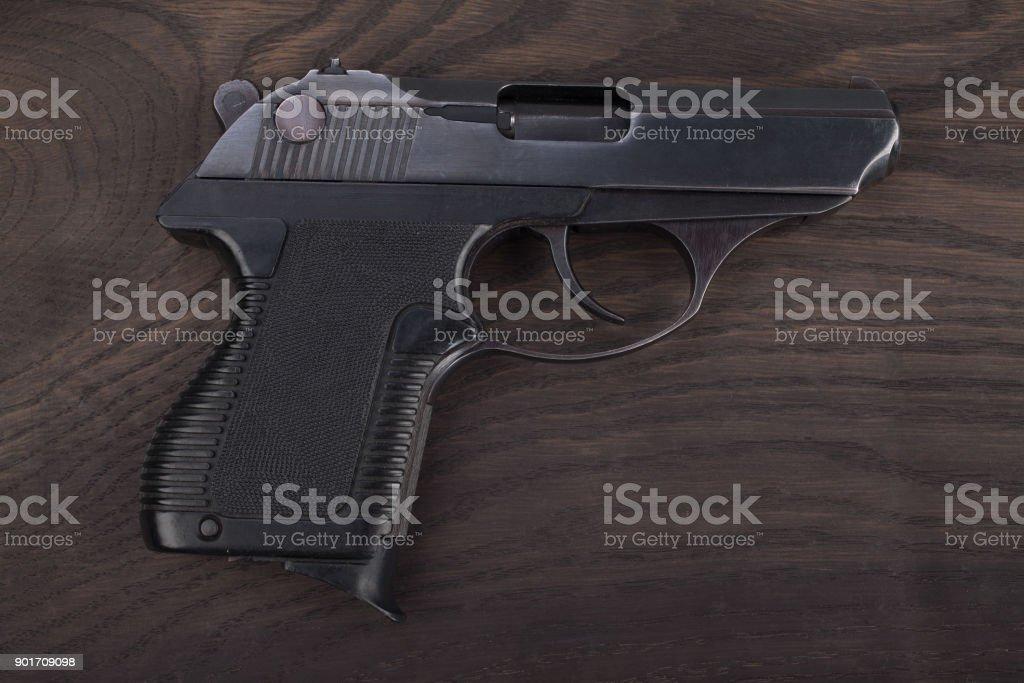 handgun on the wooden table stock photo