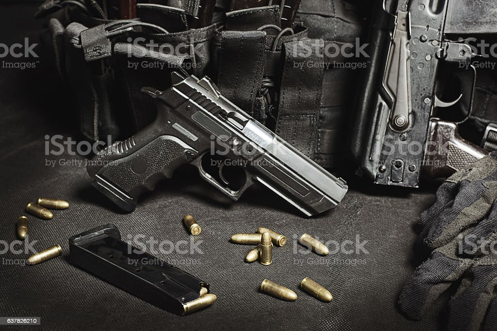 handgun with ammunition on a black surface stock photo