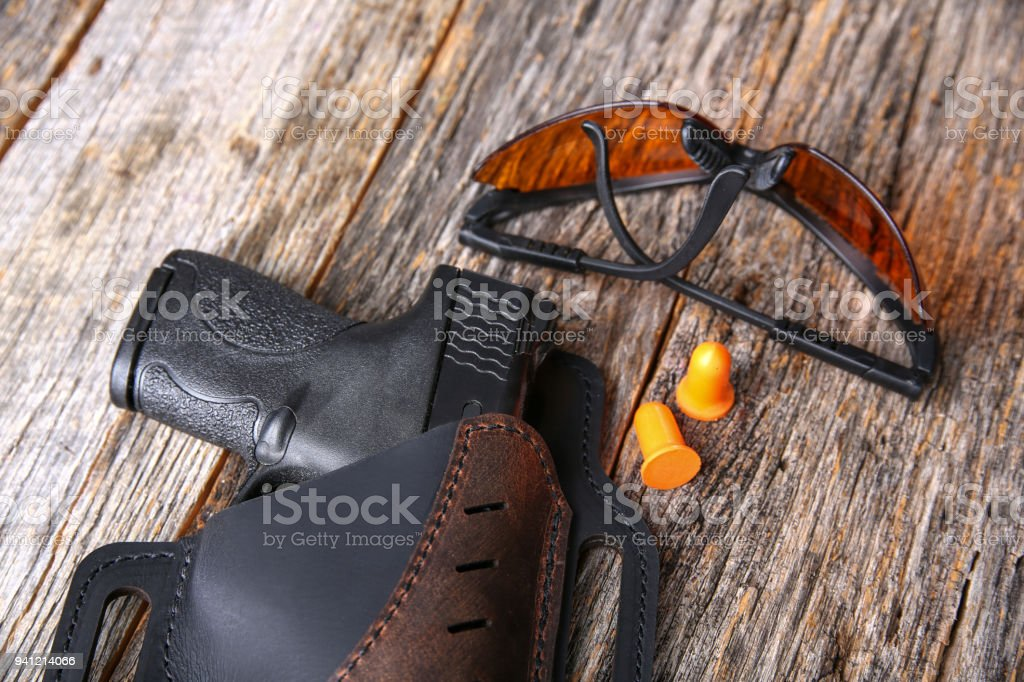 Handgun with eye and ear protection stock photo