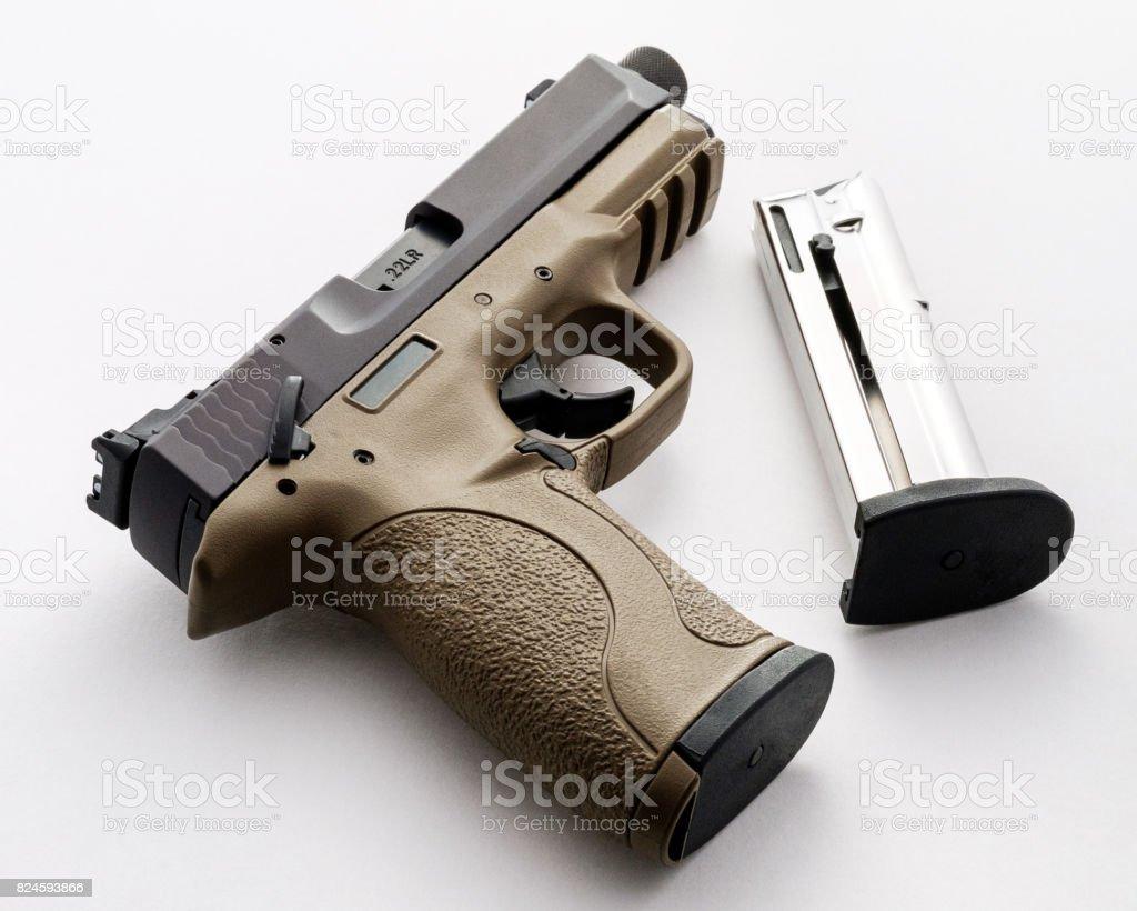 22 FDE Handgun with Threaded Barrel and Magazine stock photo