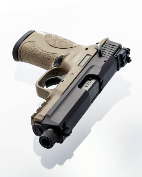 22 FDE Handgun with Threaded Barrel stock photo