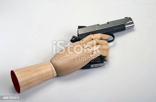 istock Handgun with wooden arm. 468762512