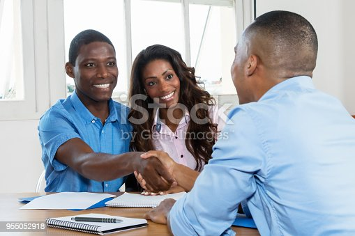 istock Handhake after signing contract with real estate agent 955052918