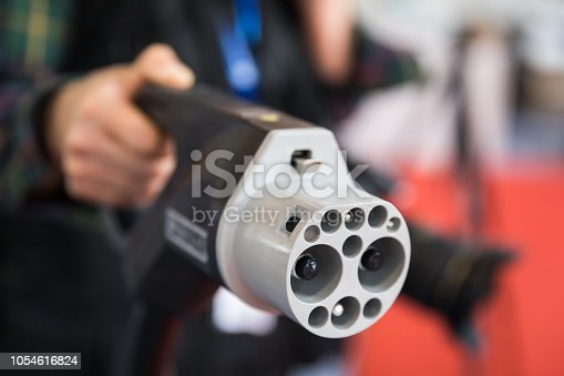 istock Handheld Power plug of electric Car 1054616824