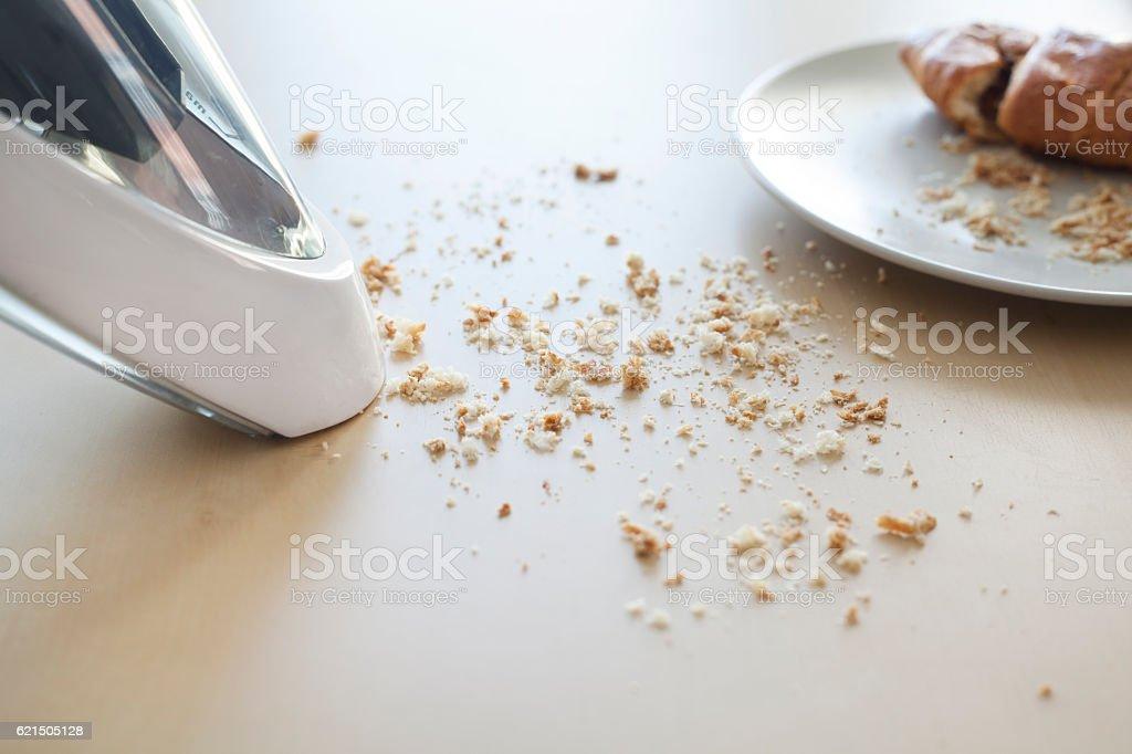 Handheld vacuum cleaning on table photo libre de droits