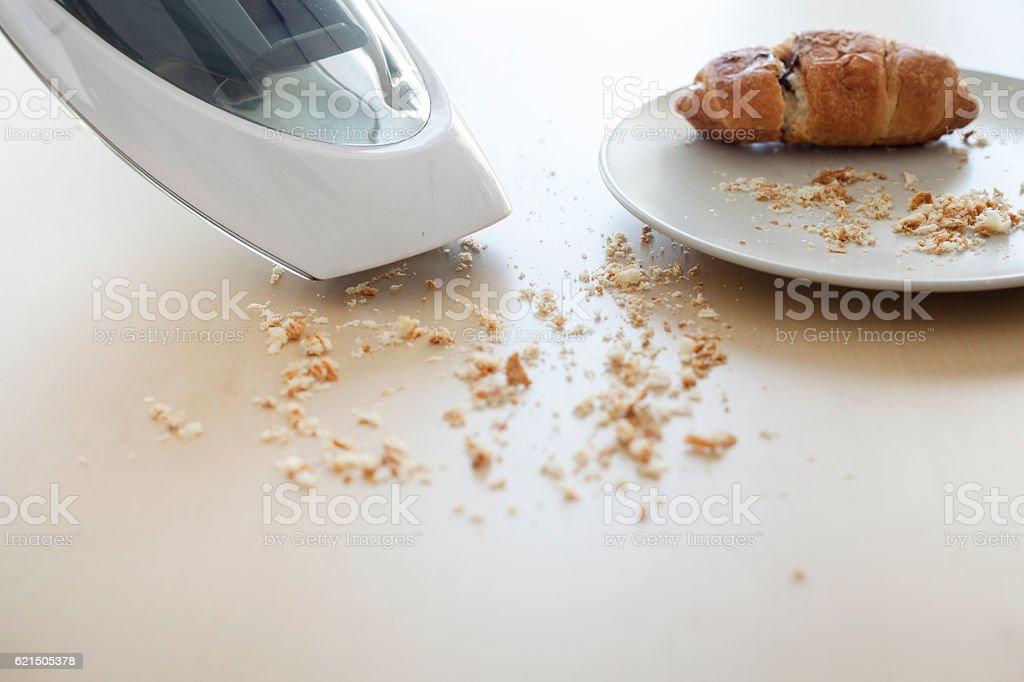 Handheld vacuum cleaning on table Lizenzfreies stock-foto