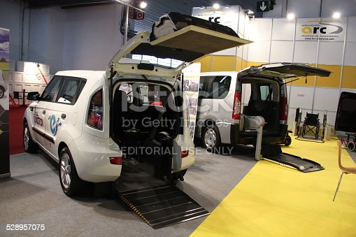 466456685 istock photo Handicap cars with wheelchair lift on the motor show 528957075