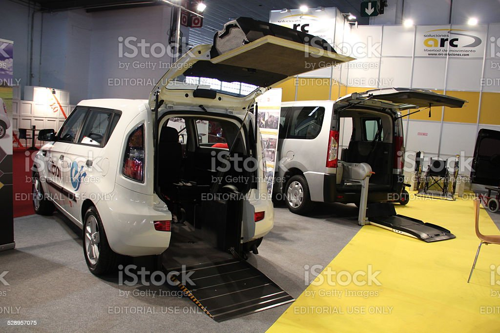 Handicap cars with wheelchair lift on the motor show stock photo