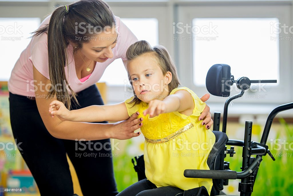 Handicap Child Doing Physical Therapy stock photo