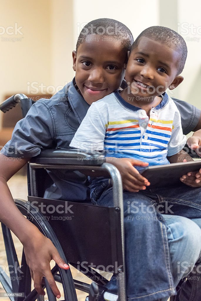 Handicap child playing with his little brother stock photo