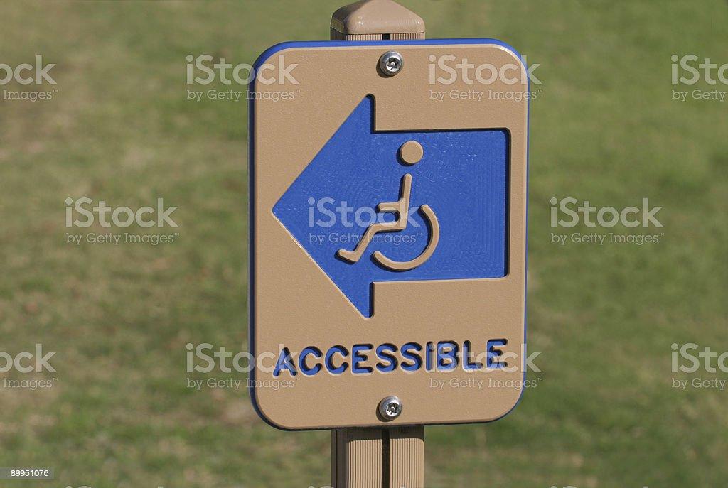 Handicap Directional Sign stock photo