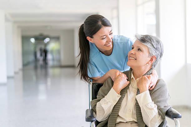handicap patient at the hospital - geriatría fotografías e imágenes de stock